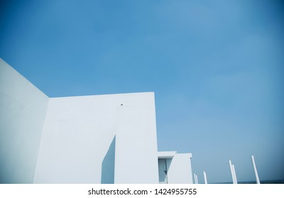 White concrete building with blue sky background photo