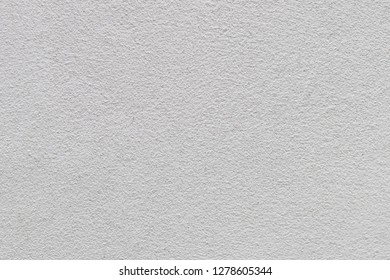 White concrete stone wall texture for background.