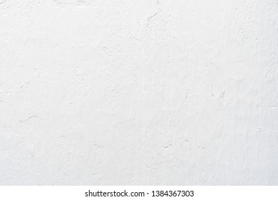 White concrete texture on wall with sunlight for abstract background.
