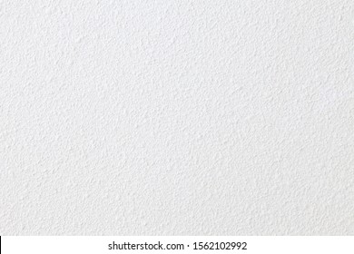 White concrete wall with rustic natural texture for abstract background texture and design purpose