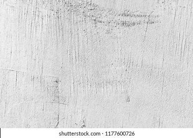 White concrete wall with stucco relief, close-up background texture