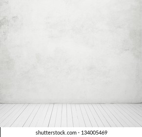 white concrete wall and white wood floor