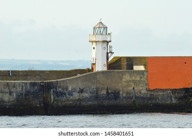 The white conical tower Aberdeen North Pier lighthouse was built on the edge of Aberdeen harbour in 1866