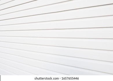 White construction vinyl siding panels as background