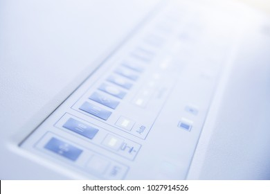 White control panel of the device with a lot of buttons. Button on panel.