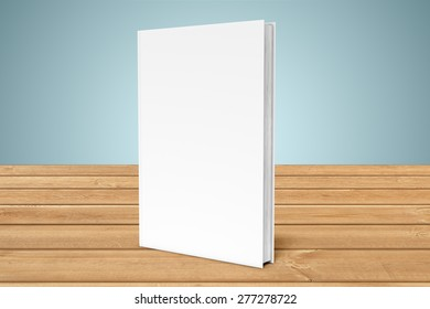 White copy-book are on the edge of a wooden table
