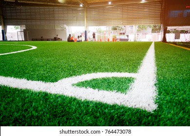White Corner Line of an indoor football soccer training field with blurred background for soccer backdrop and sport concept design.