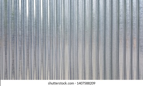 White Corrugated metal or zinc texture surface or galvanize steel in the vertical line background or texture