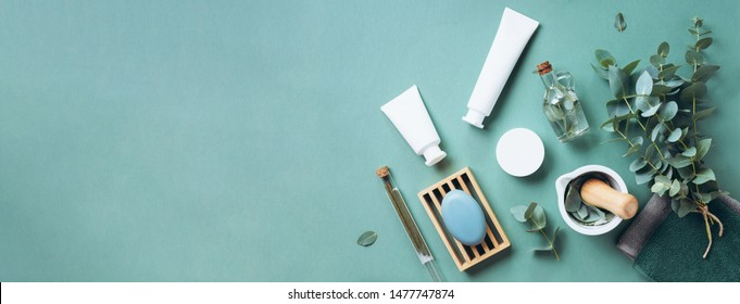 White cosmetic bottles, eucalyptus flowers, towels, soap on green background. Top view, flat lay. Natural organic beauty product concept. Spa, skin care, body treatment - Shutterstock ID 1477747874