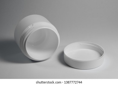 white cosmetic jars for storing creams