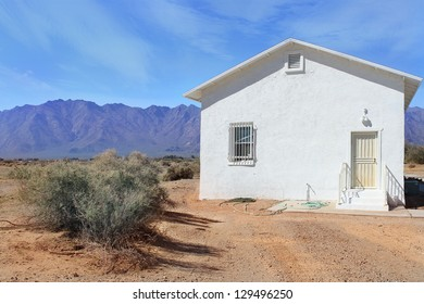 White Cottage in Desert Solitude