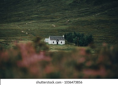 White cottage near Glencoe in the highlands of Scotland