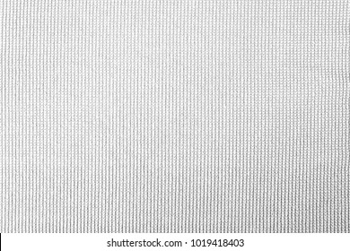 White cotton fabric woven canvas texture with gray pattern background. Soft focus linen sack craft design.