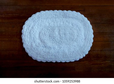 White Cotton Oval Rug with Wood Floor Background
