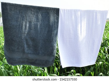 WHITE COTTON TOWEL HANGING IN THE OUTSIDE AREA. HOTEL TOWEL. SPA TOWEL. WHITE COTTON TOWEL.