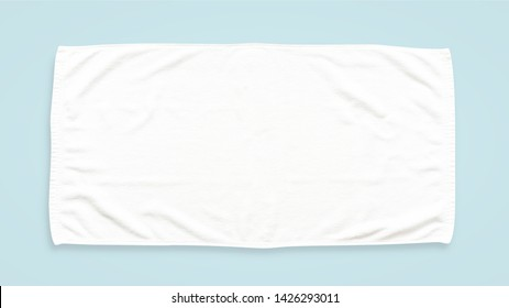 White cotton towel mock up template fabric wiper isolated on blue background with clipping path, flat lay top view