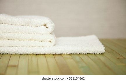 White cotton towels on bamboo background