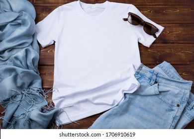 White women's cotton T-shirt mockup with blue jeans, sunglasses and turquoise scarf. Design t shirt template, tee print presentation mock up - Shutterstock ID 1706910619