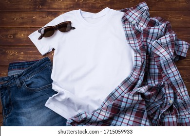 White men's cotton T-shirt mockup with checkered tartan plaid shirt and sunglasses. Design t shirt template, tee print presentation mock up