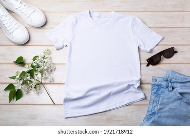 White women's cotton T-shirt mockup with lilac, blue jeans, sport shoes and sunglasses. Design t shirt template, tee print presentation mock up - Shutterstock ID 1921718912