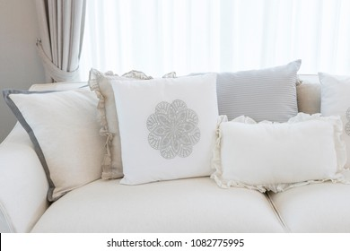 white country style sofa with many elegance cushions on it