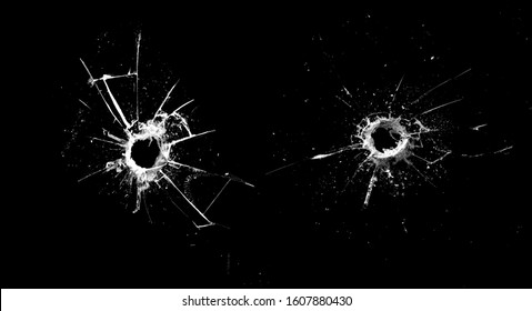 white cracks in the glass isolated on a black background
