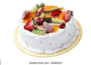 White cream cake with mixed fruity isolated on white background.