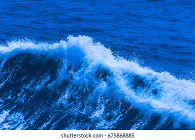 White crest of a sea wave. Selective focus. Shallow depth of field. Toned.