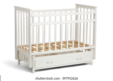 White crib for kids without mattress with a compartment for storage,  isolated on white background