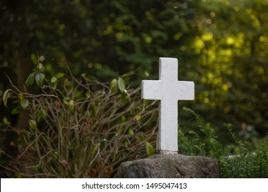 White cross on a gravestone