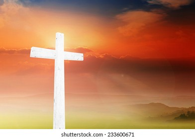 The white cross over a sunset background.