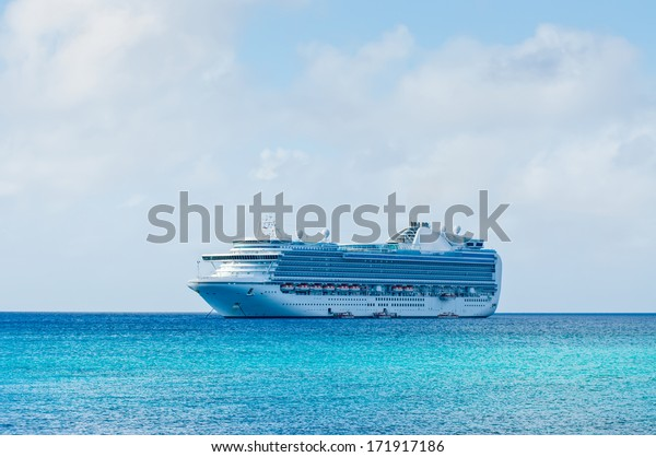 white cruise ship on a clear day with calm seas and blue sky