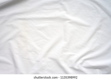 White Crumpled Bedspread Soft Fabric Textured Background