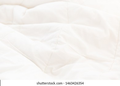 White crumpled blanket background texture, soft fabric texture background wallpaper.