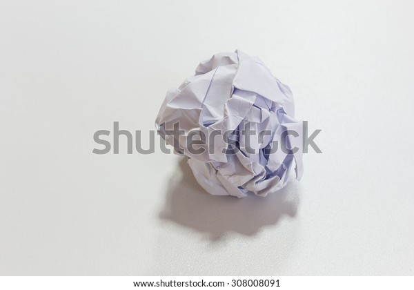 White crumpled paper put on the desk.