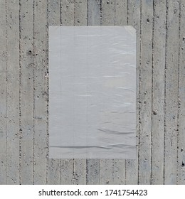 White crumpled paper wheatpaste poster on concrete wall background. Design element.