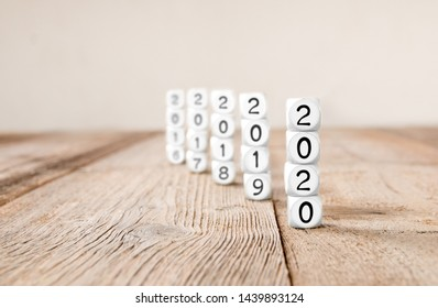 White cube blocks with 2020, 2019, 2018, 2017... imprinted; focused on 2020; concept of new year and time
