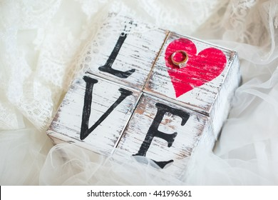 White cubes with word Love and wedding ring