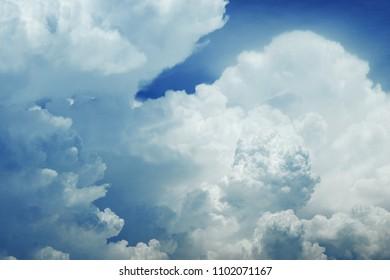 white cumulonimbus cloud on blue sky