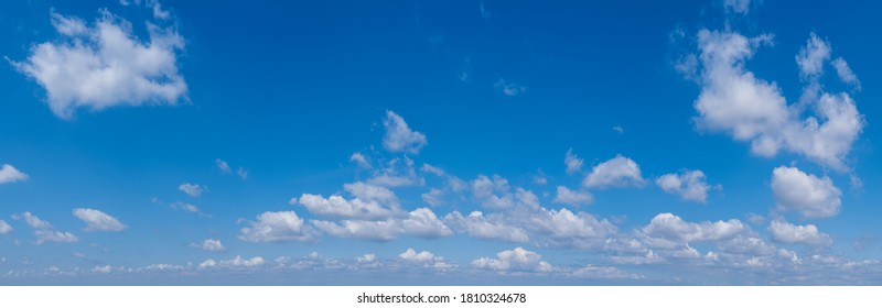 White cumulus clouds in blue sky panoramic high resolution background - Shutterstock ID 1810324678