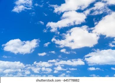 White cumulus clouds in blue sky, natural photo background