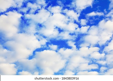 White cumulus clouds on blue sky background close up, fluffy cirrus cloud texture, beautiful cloudscape view, heaven on sunny summer day, cloudy weather, cloudiness backdrop, azure skies, ozone layer - Shutterstock ID 1843803916
