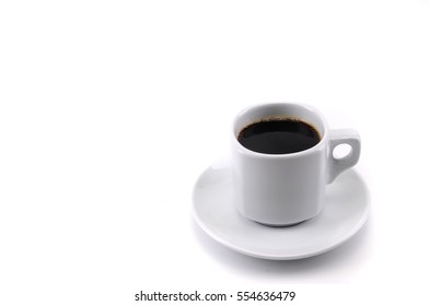 a white cup of black coffee on white background