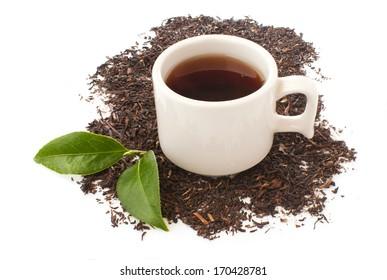white cup, black tea, green tea leaves