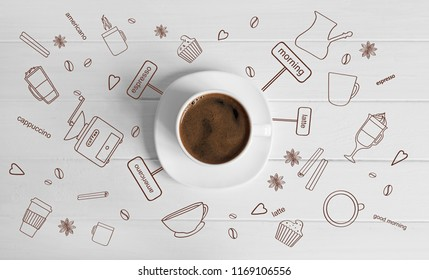 A white cup of brewed coffee with pretty brown thematical pictures around on the white background