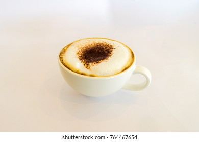 White cup of Cappucino coffee on white background.