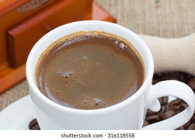 White cup of coffe