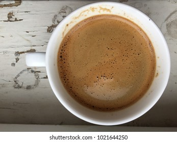 a white cup of coffee