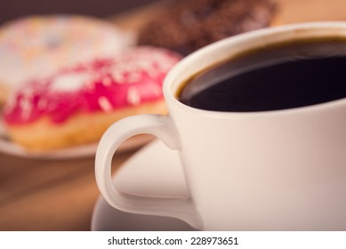 white cup of coffee and baked