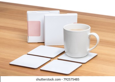 White cup of coffee with a blank white coasters.